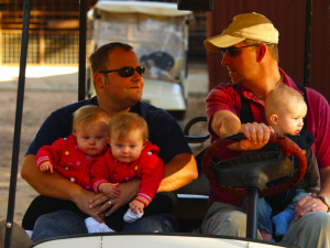 British dads enjoy showing their babies the guest ranch.