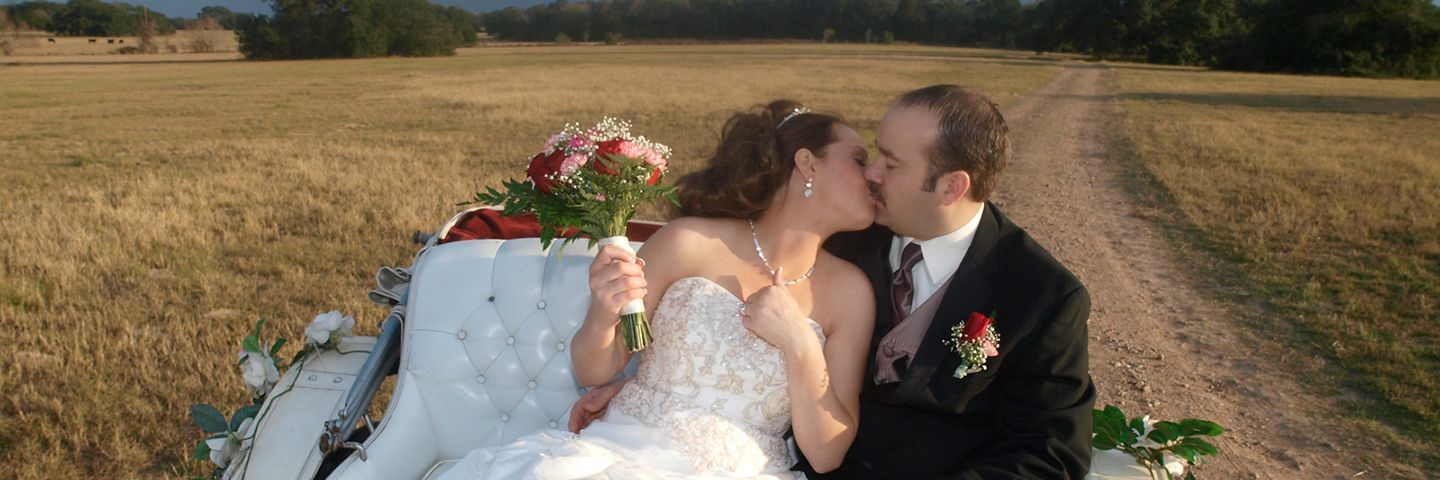 Kissing Bride and Groom at a TX Wedding