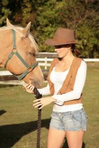 A woman handling a horse