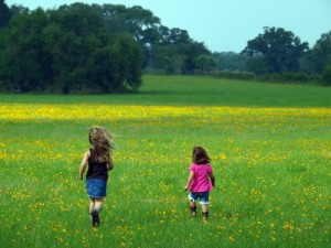Kids running through a field