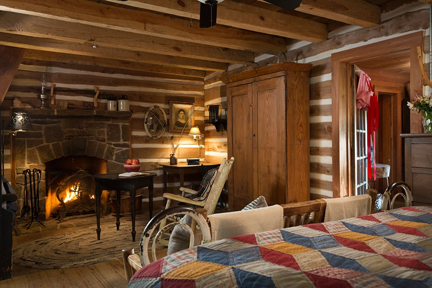 Rustic log cabin at a texas ranch bed and breakfast with stone fireplace