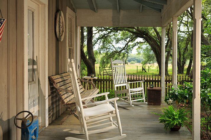 Texas Vacation: A porch with rocking chairs and view of the Ranch