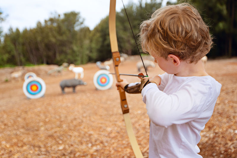 Little boy playing Archery at Blisswood