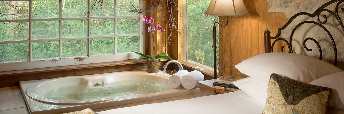 Romantic whirlpool tub in luxurious guest room at Texas bed and breakfast