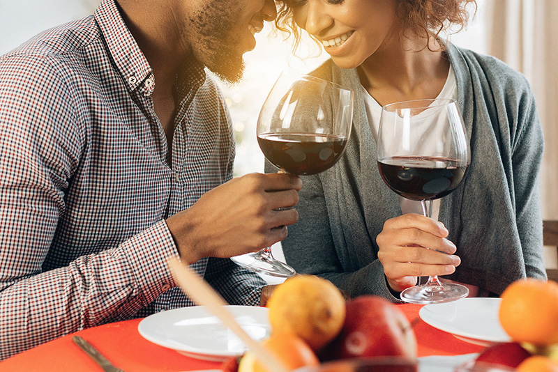 Couple enjoy red wine at our restaurant near Houston TX
