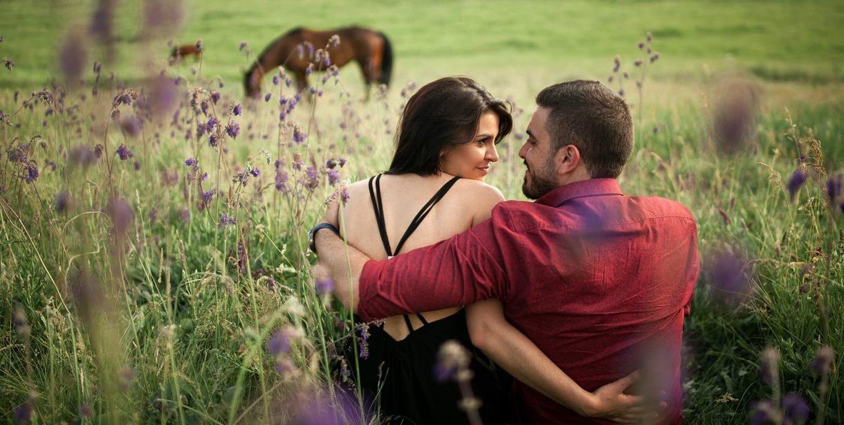 Couple enjoying a romantic picnic after horseback ride