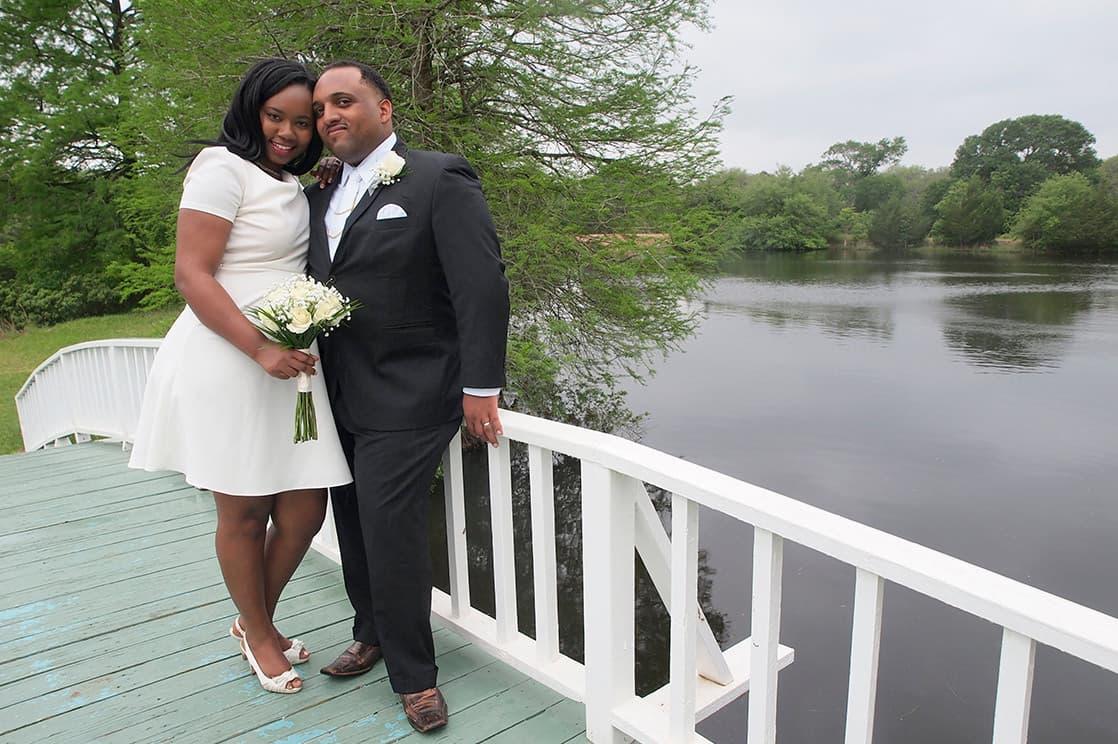 Newlyweds on the bridge at the lake