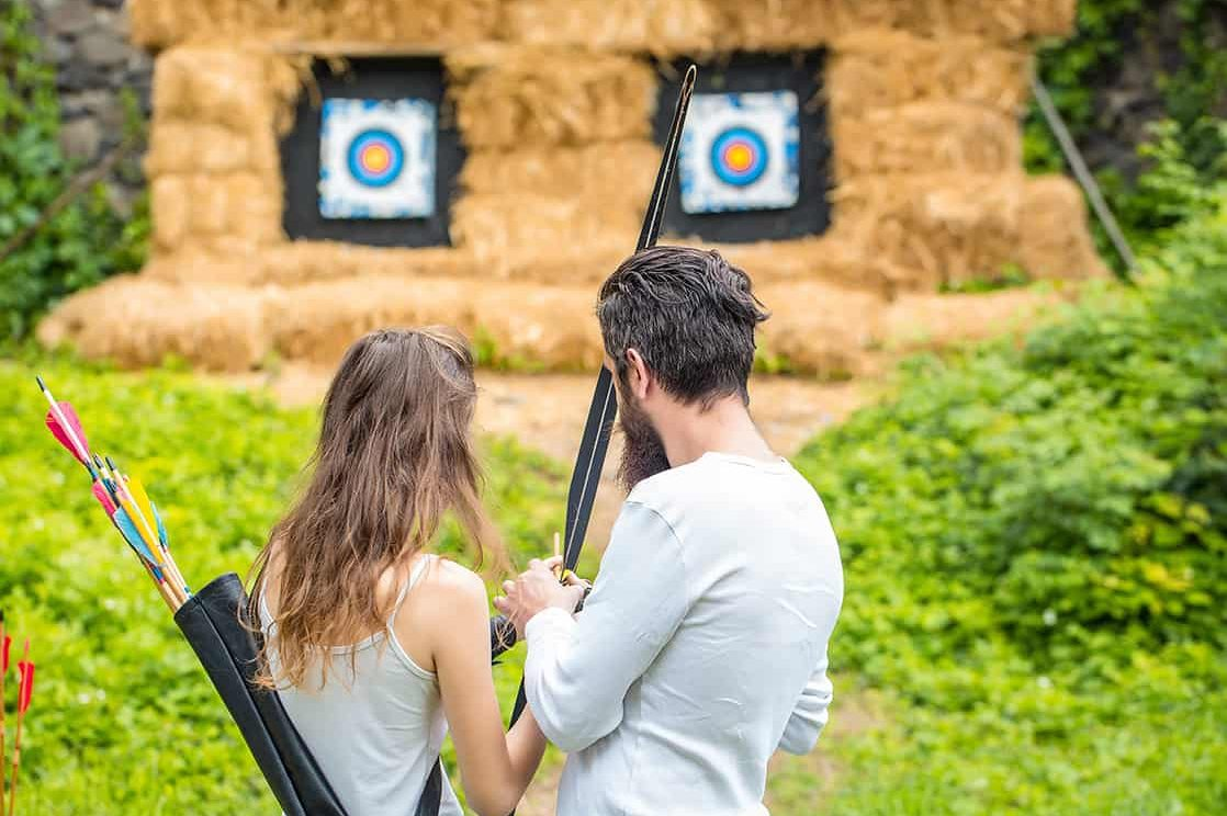 Couple practicing archery