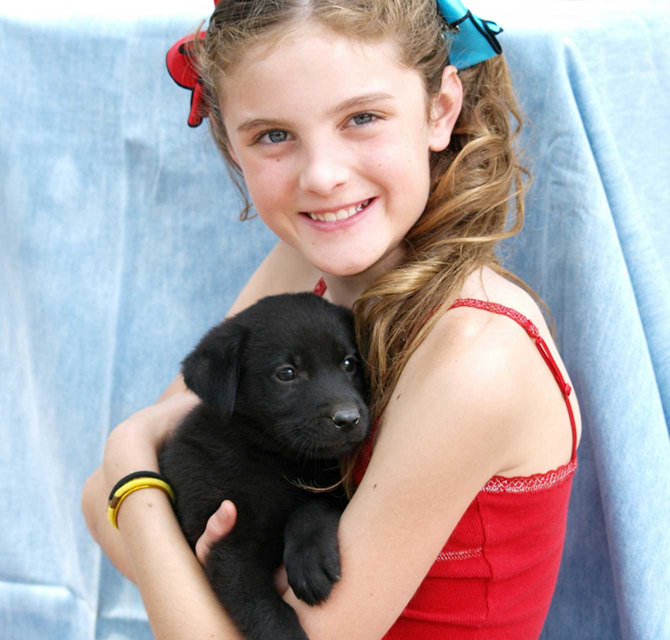 Girl holding cute puppy