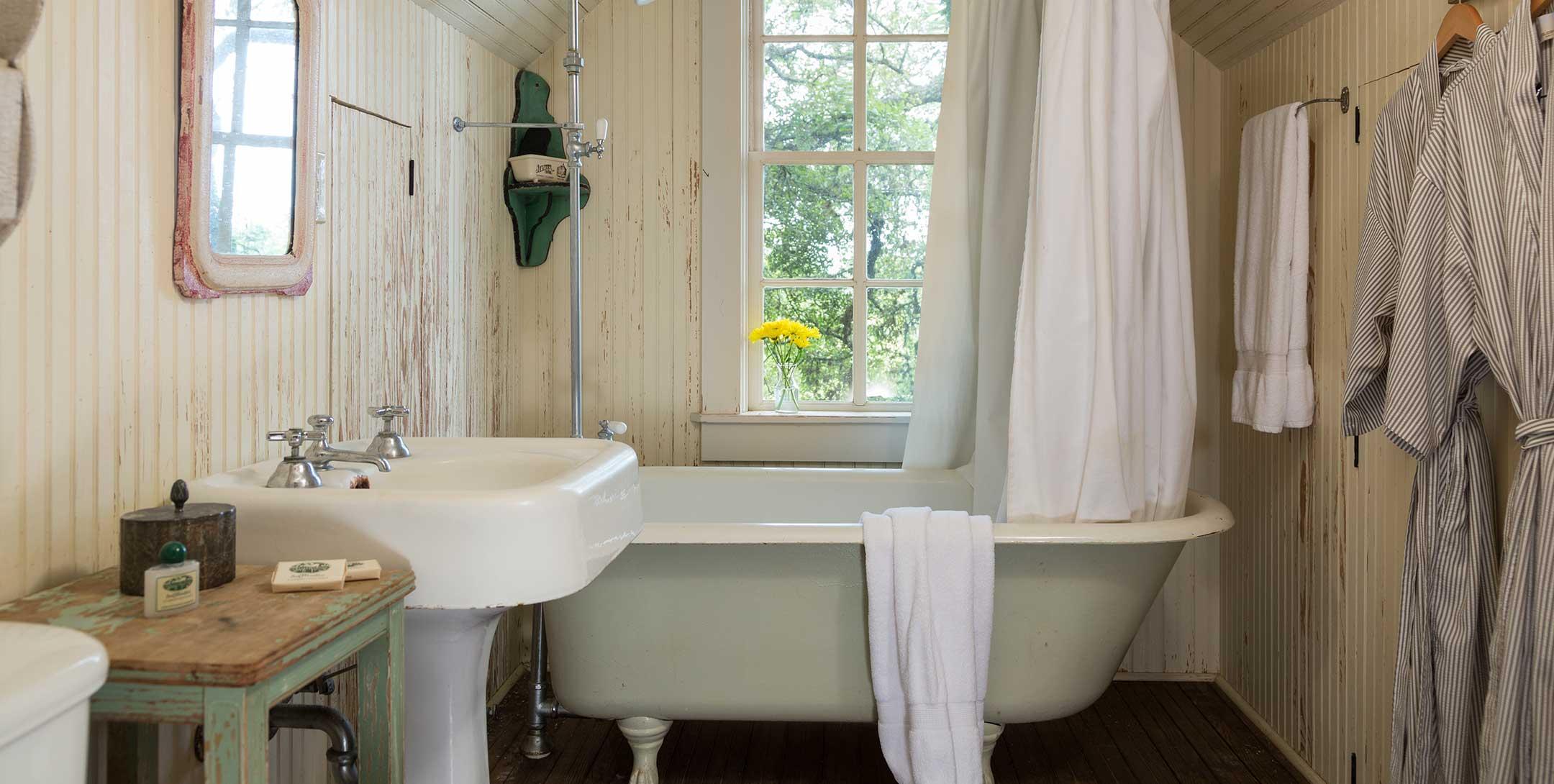 Texas Farm House bath with claw-foot tub