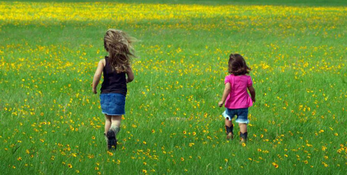 Kids running in a meadow