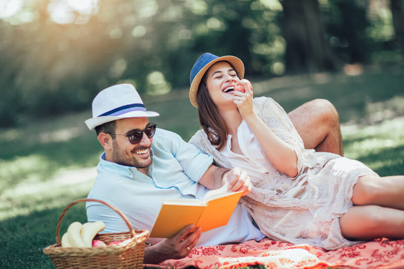 couple having a picnic in a park