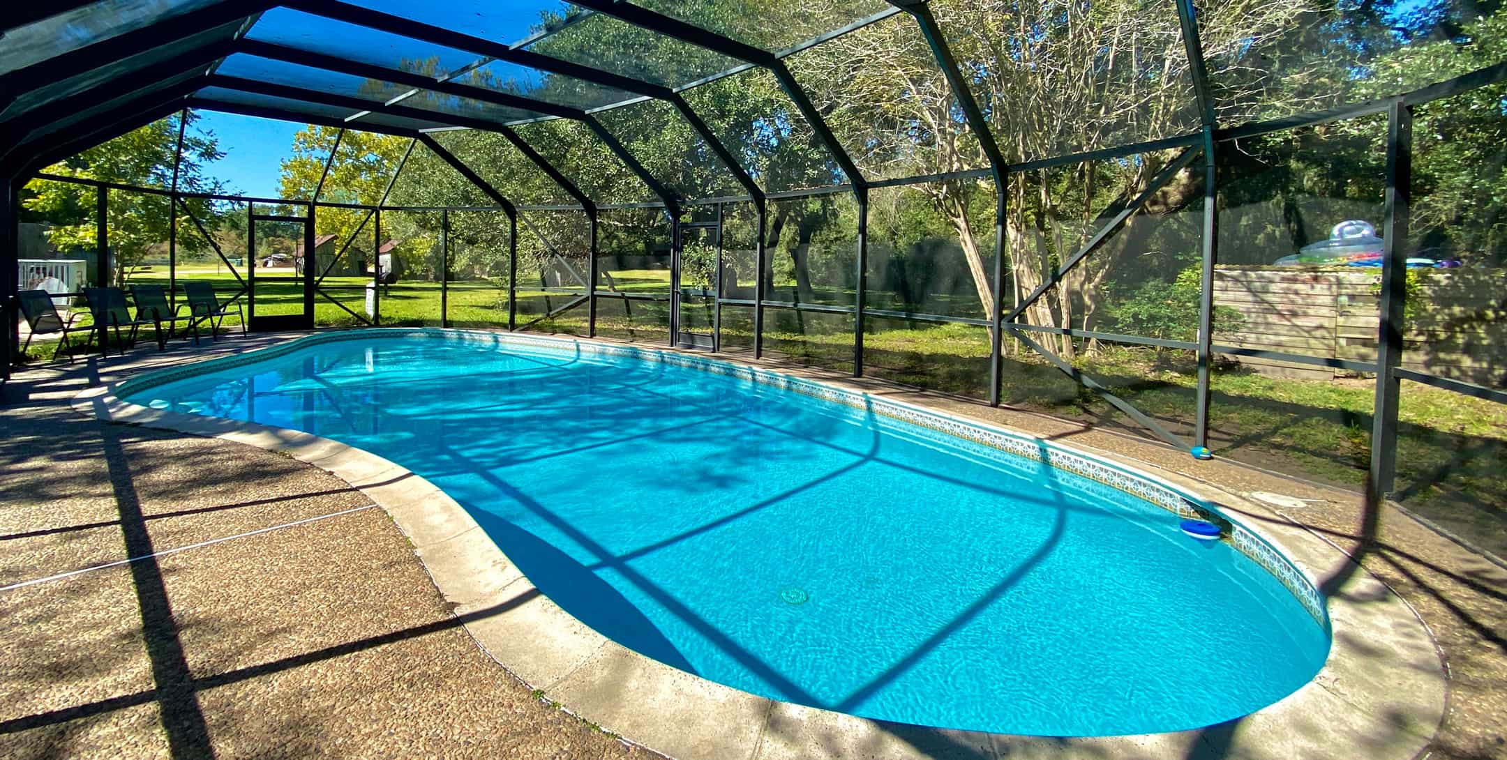 Cool down on a hot Texas Summer day in your private enclosed pool