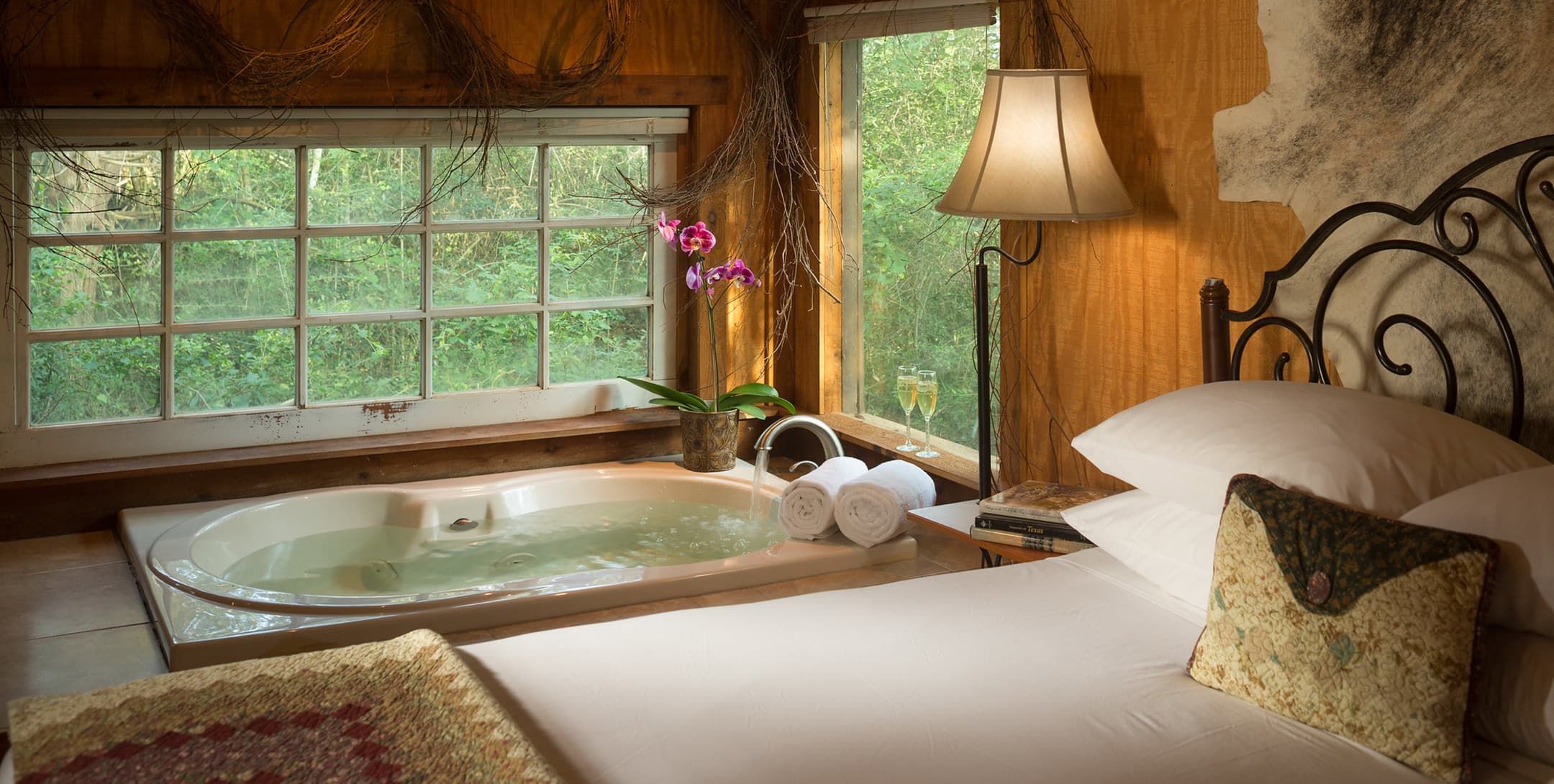 Bed and soaking tub in the Enchanted Cabin