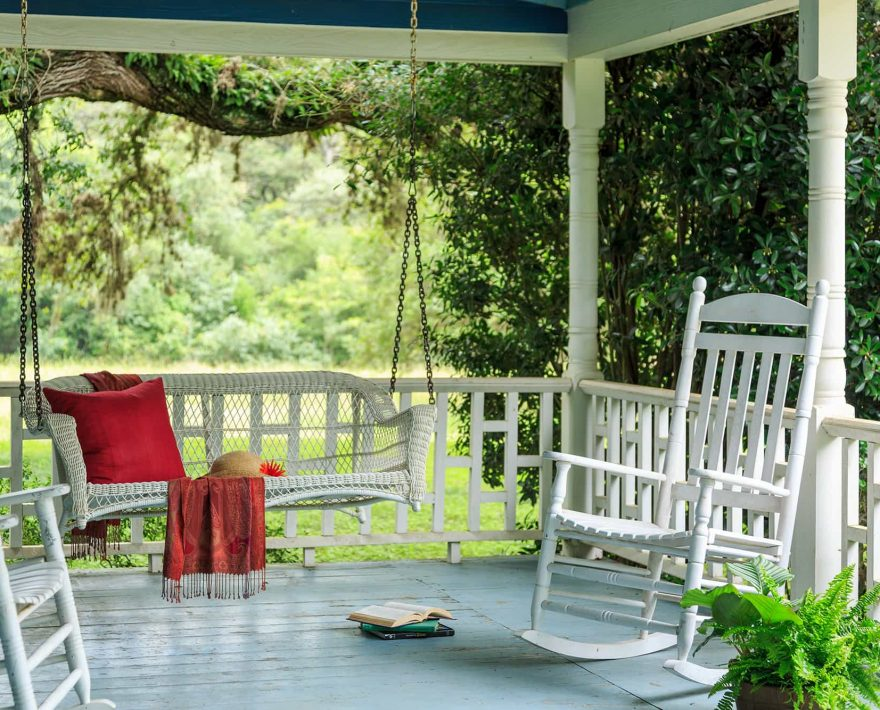 Front porch of the Lehmann House with swing and rocking chairs