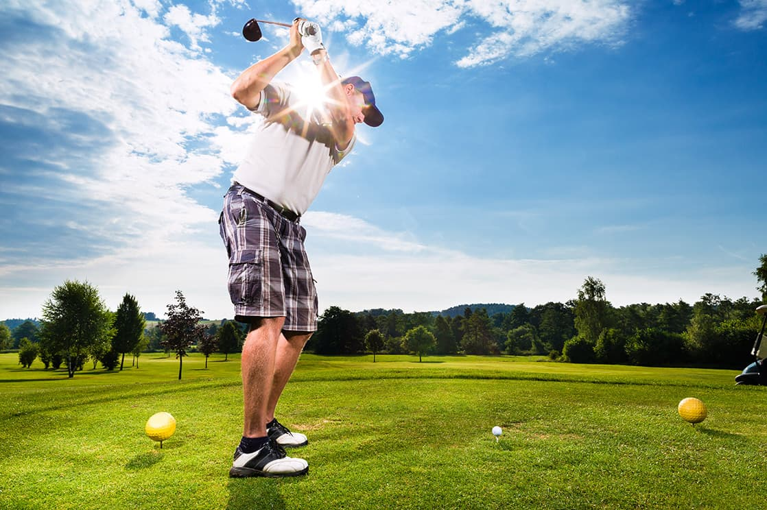 man golfing on a sunny day