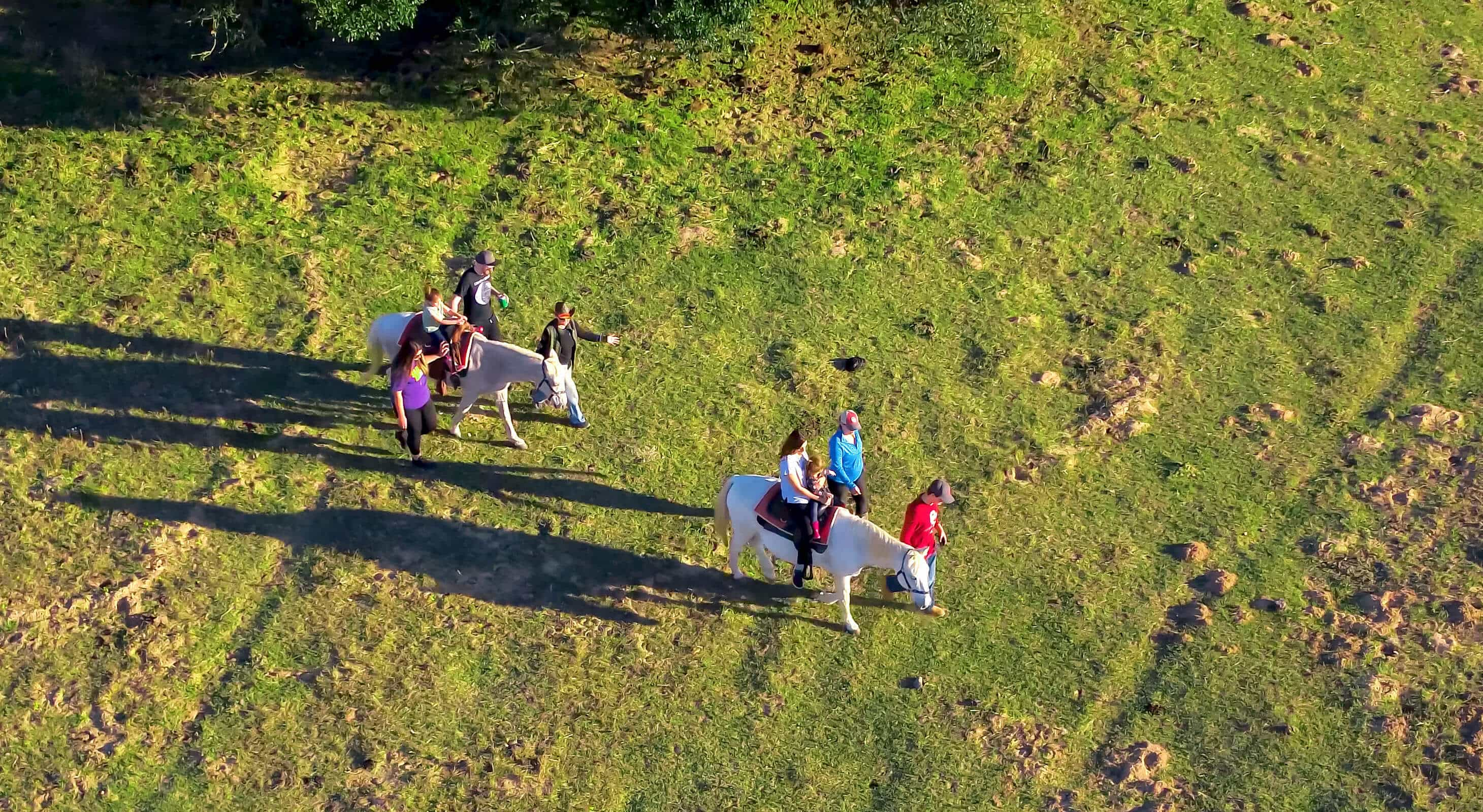 kids horseback riding on Texas family vacations