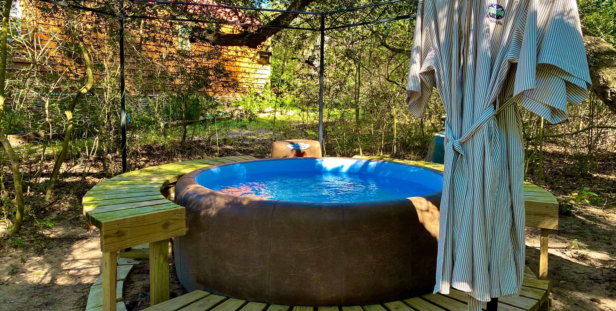 Soak and relax in the Sunset Pond Cabin hot tub in a private secluded setting