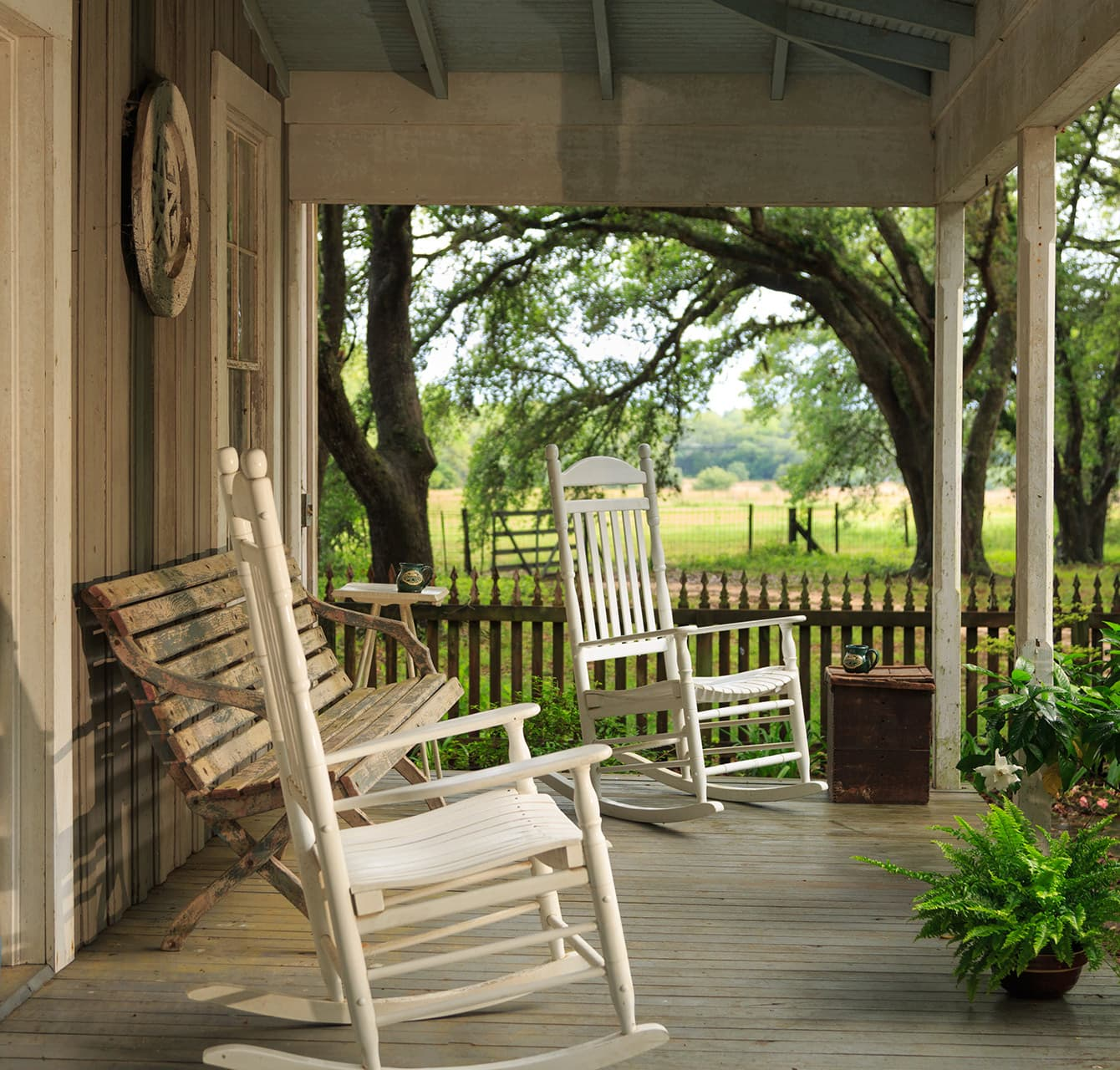 Texas Farmhouse front porch with white rocking chairs