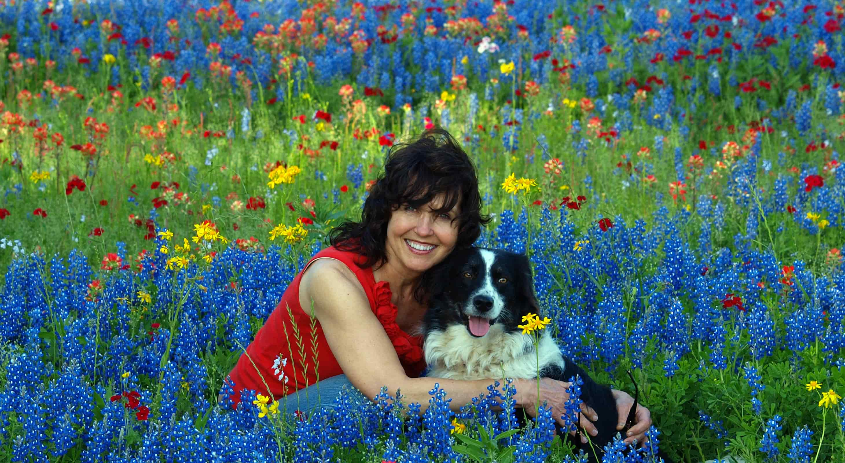 woman with dog in Texas wildflowers