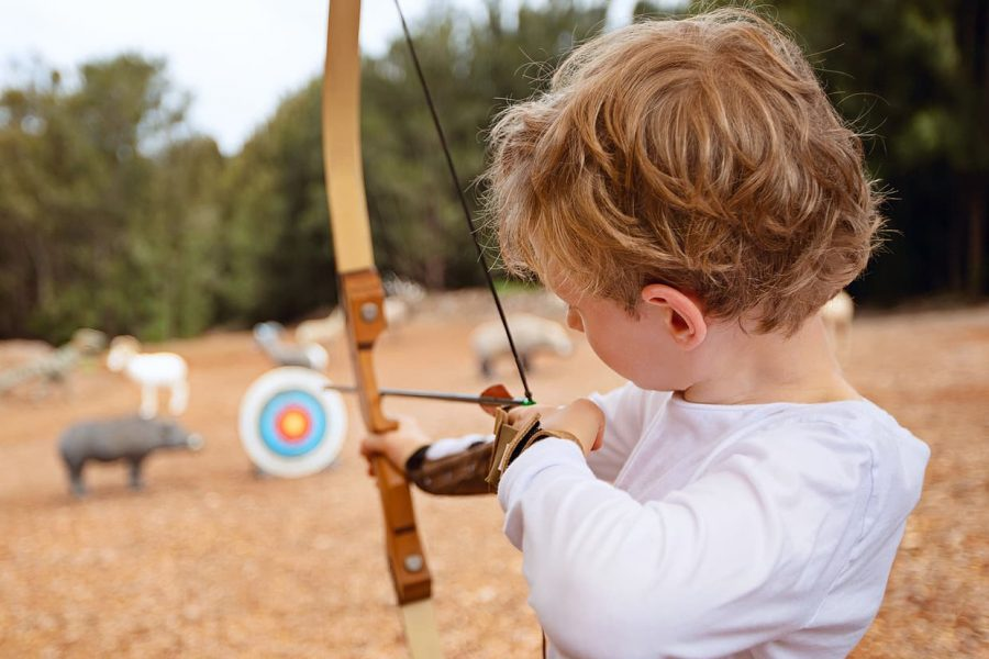 Boy trying archery on a kid friendly vacation in Texas