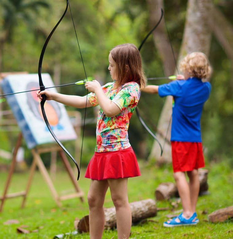 two kids doing archery activity