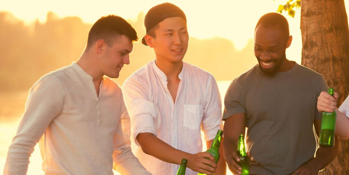group of men with beers outdoors