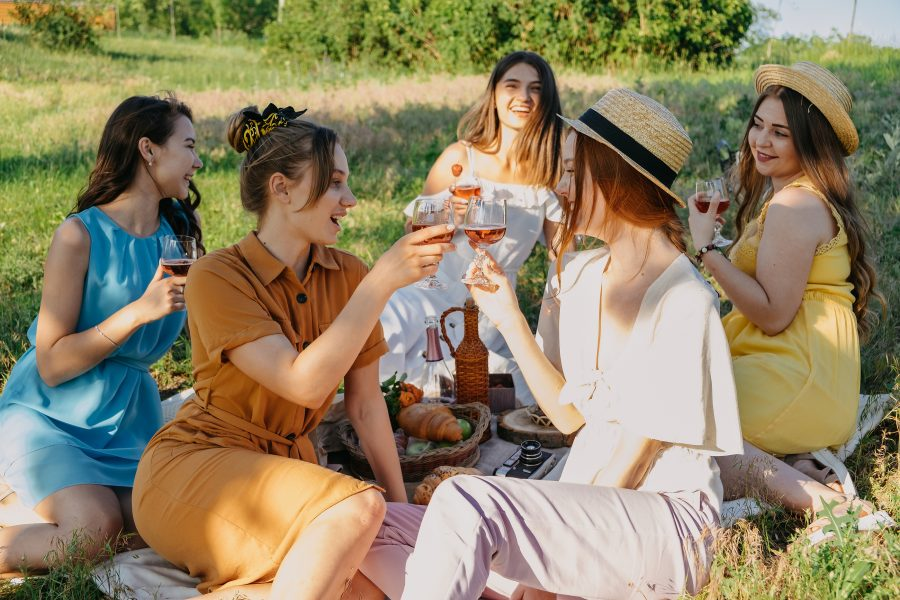 a group of women having a picnic in a park