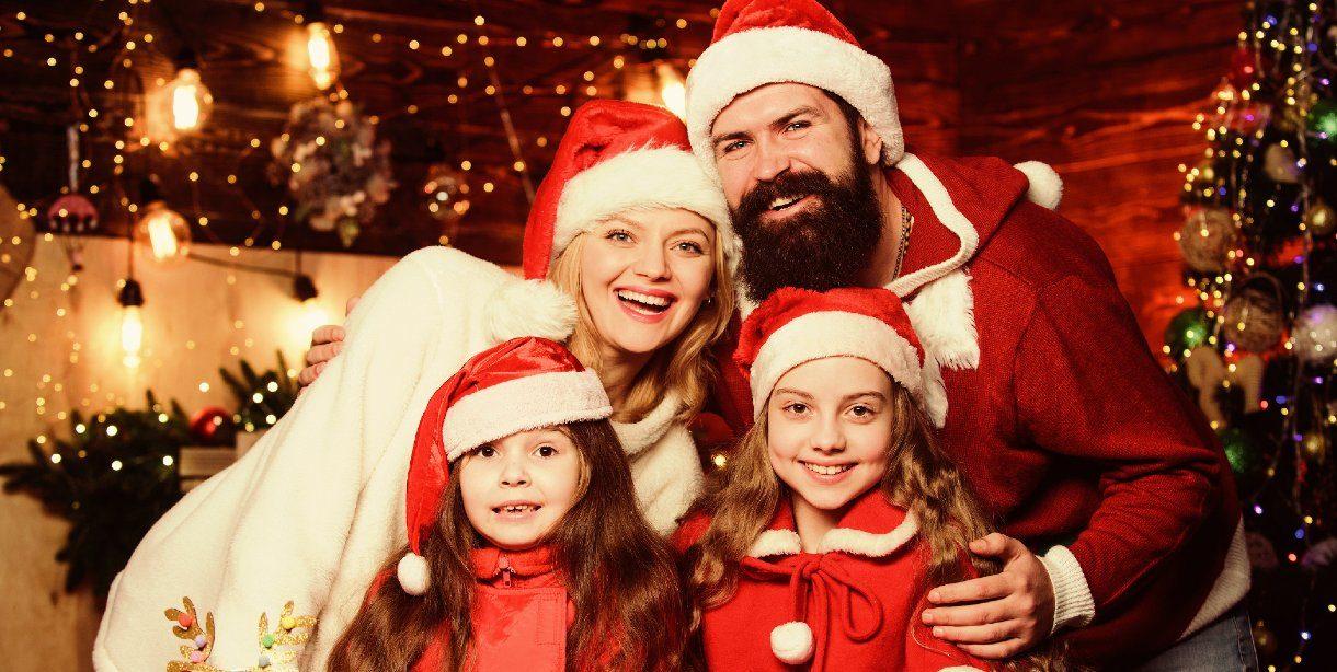 family in santa hats at Christmastime