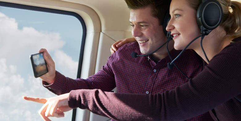couple on a helicopter tour of BlissWood Ranch